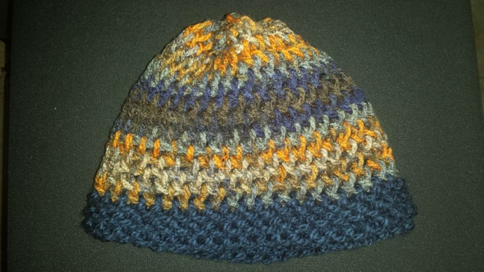 Loom knitted reversible hat by Kim M.