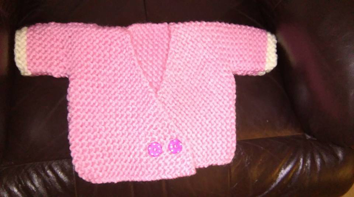 Loom knitted baby kimono sweater by Cheryl P.