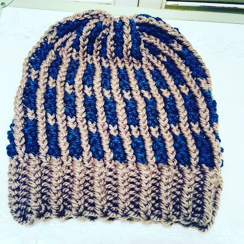 Loom knitted bicolor hat by Nicole R.
