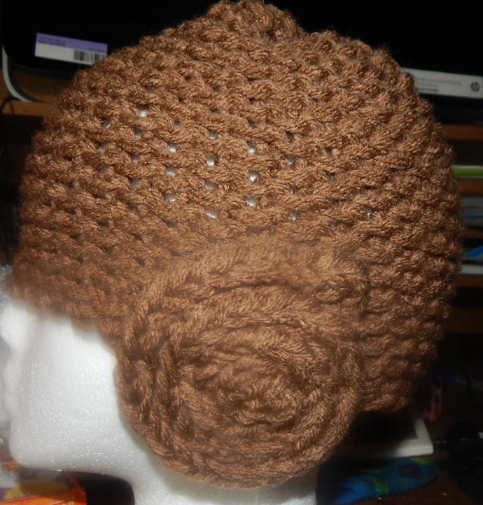 Loom knitted Princess Leia hat by Malisa W.